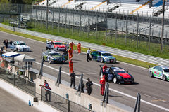 Cars and technicians on the grid at Monza circuit Stock Photo