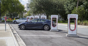 Cars at Tesla charging stations Stock Image