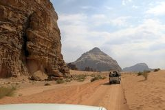 CARS of tourists in the desert of Jordan Stock Image