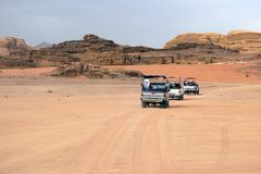 Cars of tourists in search of adventures in the desert Stock Images