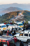 Cars and tourists are wearing coat with mountain and trees in background in the morning at The Tiger Hill in winter at Tiger Hill. Cars and tourists are wearing Royalty Free Stock Photography