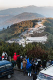 Cars and tourists are wearing coat with mountain and trees in background in the morning at The Tiger Hill in winter at Tiger Hill. Cars and tourists are wearing Royalty Free Stock Images