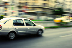 Cars in traffic. Traffic concept with cars on street with motion blur Royalty Free Stock Photography
