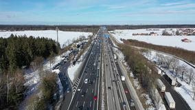 Cars traffic on direct highway at sunny winter frosty morning. Aerial view. Cars traffic on direct highway at sunny winter frosty morning stock video footage