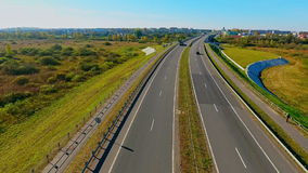 Cars traffic on highway road. Drone view highway landscape. Highway road. Aerial motorway. Cars moving on highway road. Cars and trucks driving on country road stock footage
