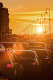 Cars are in traffic jam during a beautiful golden sunset. Royalty Free Stock Photos
