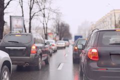Traffic jam on a city street  on wet  road after rain Stock Photo