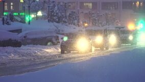 Cars are in traffic jams because of snow storm.  stock video