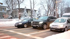 Cars at traffic light in the winter Stock Image