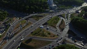 Cars traffic on road junction in city. Drone view car highway intersection stock video