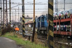 Cars on the train. Cars ŠKODA/SKODA on the train arriving to the station Nymburk hl.n Stock Photos