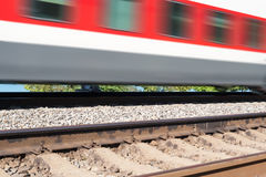 Cars of the train moving on rails. In clear summer day Stock Photo