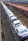 Cars on train waiting delivery. New cars on a train awaiting delivery Stock Photo