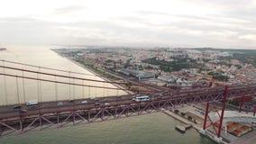 Cars, trains, bus on 25 April bridge in Lisbon aerial view. Transportation on 25 April bridge in Lisbon stock video footage