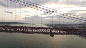 Cars, trains, bus on 25 April bridge in Lisbon aerial view. Transportation on 25 April bridge in Lisbon stock video