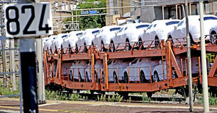 Cars transport on the train. Civitavecchia Rome Italy A italian freight train is a freight train that travels from the point of loading to the unloading point as Royalty Free Stock Images
