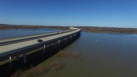 Cars traveling across a bridge over Hickory Creek on Lake Lewisville. stock video footage