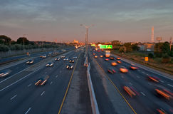 Cars traveling on a busy highway in the morning. Beating the morning rush hour at sunset Stock Image