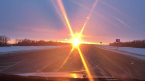 Cars traveling motion on the road winter snow sunlight sunrise travel stock video footage