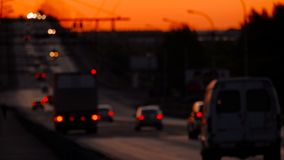 Cars traveling on overpass road in sunset light. Defocused stock video