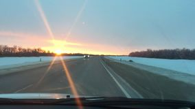 Cars traveling on the road motion winter snow sunlight sunrise travel stock video footage