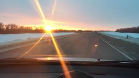 Cars traveling on the road winter motion snow sunlight sunrise travel stock video