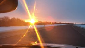 Cars traveling on the road winter snow motion sunlight sunrise travel stock footage
