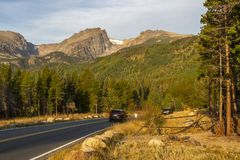 Cars traveling up Bear Lake Road in Rocky Mountain National Park stock images