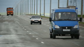 Cars and Truck Move along Highway with lights Towards Camera. KAZAN, TATARSTAN/RUSSIA - JUNE 08 2015: Closeup cars and truck move along highway with high lights stock video