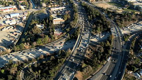 Cars and trucks on freeway aerial stock video footage