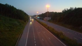 Cars and trucks on a highway. Cars and trucks driving on a highway under a blue sky in spring sunset stock footage