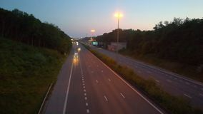 Cars and trucks on a highway. Cars and trucks driving on a highway under a blue sky in spring sunset stock video footage