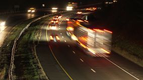 Cars and trucks on a highway stock footage