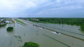 Cars and trucks trying to drive through flooded i45 near Houston Texas stock footage