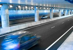 Cars in a Tunnel. Cars Moving in a Highway Underground Tunnel Royalty Free Stock Images