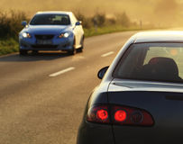 Cars. Two cars on road at sunshine Royalty Free Stock Photography