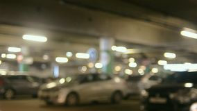 Cars on undeground parking. Of a mall. Blurry soft background stock video