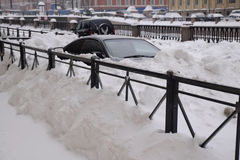 Cars Under Snow. Car in the snowbank on the street of St.Petersburg in Russia during Russian Christmas holiday Stock Photo
