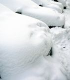 Cars under the snow. Parking cars, covered with a thick layer of snow stock photos