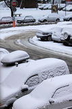 Cars under snow. A winter day with parked cars trapped under snow Royalty Free Stock Image