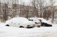Cars under snow on parking Stock Photography