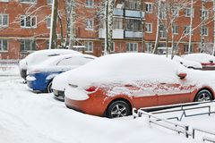 Cars under the snow. Snowfall in the city.  Stock Photography