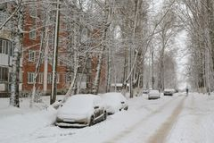Cars under the snow. Snowfall in the city.  Stock Image