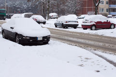 Cars under the snow in a street Stock Images