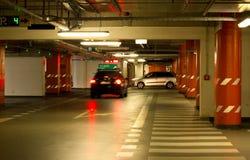 Cars in an underground garage. Modern, well lit underground garage Royalty Free Stock Photos