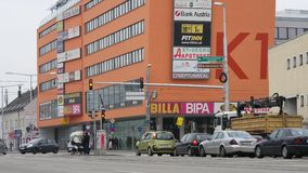 Cars Vienna. Car Traffic in Vienna in front of a modern shopping center, 4k stock video footage