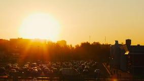 Summer sunset timelapse of parking for cars near shopping center market in town stock video