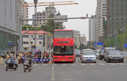 Cars are waiting for the green signal of traffic light in Kunming, China Stock Image