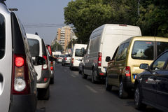 Cars in waiting in heavy traffic. Morning traffic jam in Bucharest - cars waiting in row Royalty Free Stock Photo