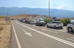 Cars in a waiting line for the car ferry. Rab island, Croatia. royalty free stock photos